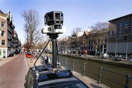 A Google Street View camera on top of a car at the Prinsengracht in Amsterdam, The Netherlands