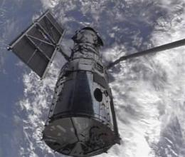 Astronauts grab Hubble, prepare for tough repairs (AP)
