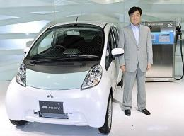 Mitsubishi Motors President Osamu Masuko introduces the company's first mass production electric vehicle