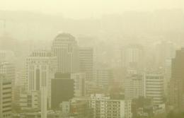 Skyscrapers in downtown Seoul are shrouded by yellow dust storms in 2006