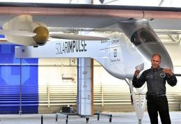 Swiss scientist-adventurer and pilot Bertrand Piccard gestures as he unveils the 'Solar Impulse' airplane