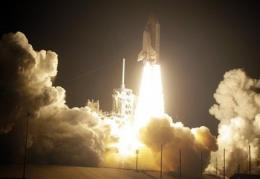 Shuttle Discovery arrives at space station (AP)