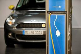 An electric car of the model Mini type E standing behind an electric charging station in Berlin