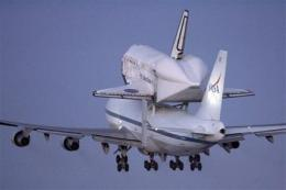 Space shuttle Discovery begins flight to Florida (AP)