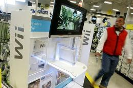 A Best Buy customer walks by a display for the new Nintendo Wii in 2006 in San Francsico, California