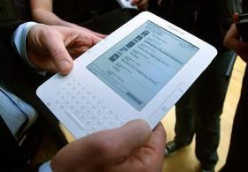 A man holds the new Amazon Kindle 2