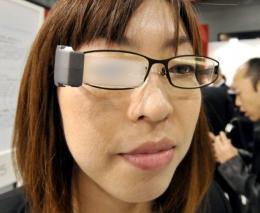 A Masunaga Optical employee displays the blinking