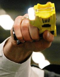 A police officer demonstrates a taser gun in 2007