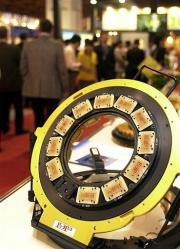 A probe pin ring, chip testing equipment, is on display at the three-day annual exhibition on seminconductor equipment