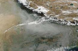 A unique geography -- and soot and dust -- conspire against Himalayan glaciers