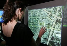 A woman looks at a multi-touch screen in Los Angeles, California