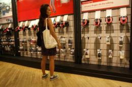 A woman shops at a Verizon store in New York City