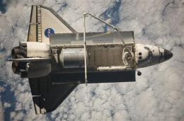 Bad weather forces shuttle to skip 1st landing try (AP)