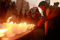 Candles are lit at a rally in support of Iranian election protesters organized by Amnesty International in New York