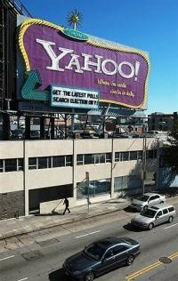 Cars drive by a Yahoo billboard