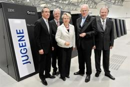 Chairman of IBM Germany Martin Jetter (left) with other officials in front of the