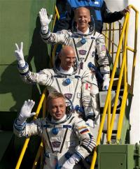 Circus tycoon, 2 crew board orbiting space station (AP)