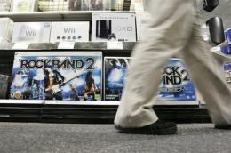 EA posts smaller 4Q loss as costs decline (AP)