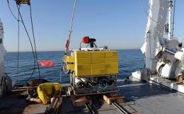 French Research Institute for Exploitation of the Sea (IFREMER) team prepares to put in water the robot BOB