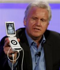 GE unveils handheld ultrasound machine (AP)