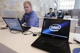 Intel profit falls but outlook upbeat, stock jumps (AP)