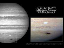 Jupiter, solar system's 'big bully,' takes a punch