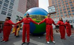 Members of Greenpeace protest in Mexico City