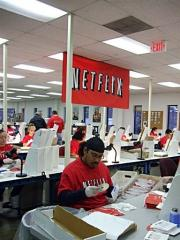 Netflix workers sort DVDs at the company's Piscataway, New Jersey, distribution center