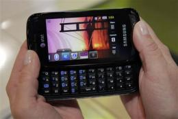 On new cell phones, QWERTY eases out 1-2-3 (AP)