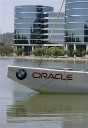 Oracle tops forecasts despite sales, profit dip (AP)