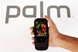 Palm posts larger 1Q loss, but beats Street view (AP)