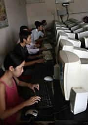 People enjoy online services at an internet shop in downtown Hanoi
