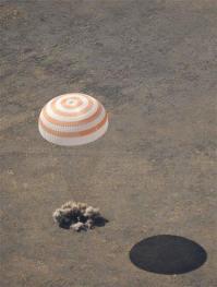 Russia space capsule carrying US billionaire lands (AP)