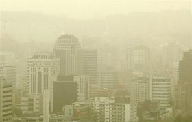 Skyscrapers in downtown Seoul in March 2006 are shrouded by yellow dust storms blowing in from China's Gobi desert