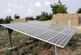 Solar pannels whose energy helps pump water into a water tower in the village of Safo Nassarawa near Maradi in Niger