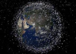 Space collision debris to orbit Earth for millenia (AP)