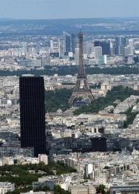 The Eiffel Tower (centre) and the Montparnasse Tower (left) in Paris