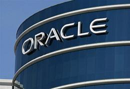 The Oracle logo is displayed on the company's world headquarters in Redwood Shores