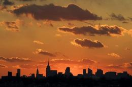 The sun sets behind the Manhattan skyline on December 11 in New York
