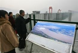 Tourists view the Three Gorges Dam in central China's Hubei province