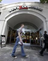 Verizon profit falls 30 pct on restructuring costs (AP)