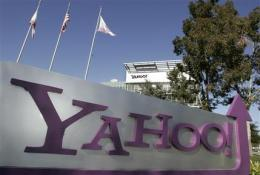 Yahoo 2Q profit up 8 pct, yet ad slump continues (AP)