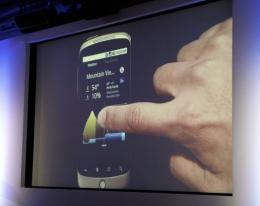 A man demonstrates a weather application on the Nexus One smartphone running the Android platform