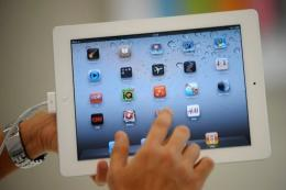 A man navigates through the iPad 2
