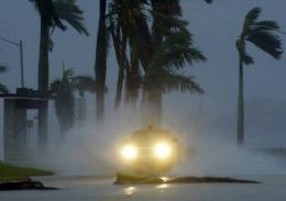 A trucks drives along a flooded street during a hurricane in Florida