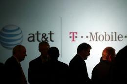 Executives at AT&T attend a news conference where it was announced that AT&T Inc. will be buying T-Mobile, in March