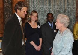 Queen Elizabeth II (R) speaks with James Cracknell and Alice Roberts (C)