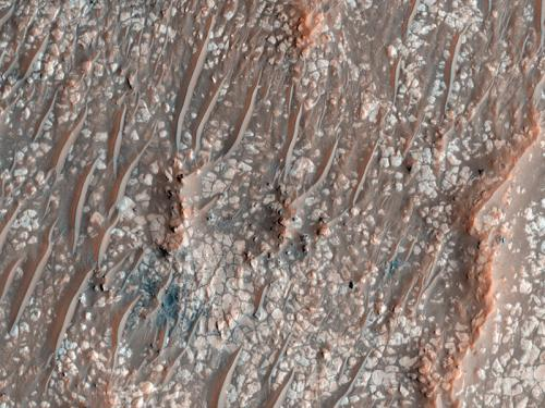 Swirls, gullies and bedrock create two jaw-Dropping etherial mars landscapes