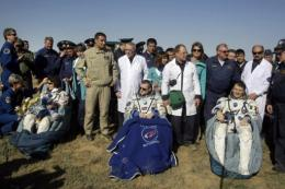 The International Space Station crew after their Soyuz capsule landed safely
