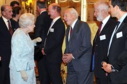 Queen Elizabeth II (2L) speaks with naturist David Attenborough (3R), Chief Scout Bear Grylls (R) and Chris Bonnington